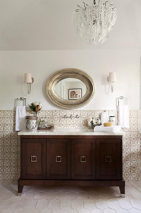 Mediterranean Style Bathroom With Oval Silver Mirror