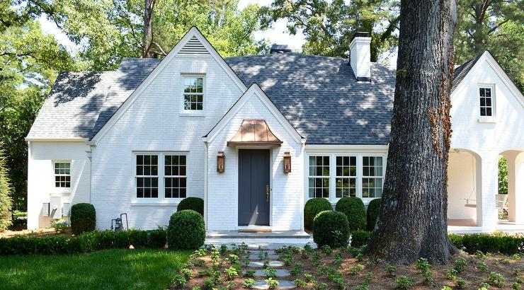 White Brick Cottage Home With Dark Gray Door Cottage