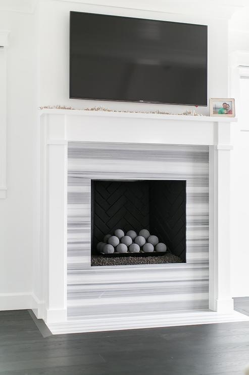 Chevron fireplace surround transitional living room benjamin moore grey tint martha o - Black and white fireplace ...