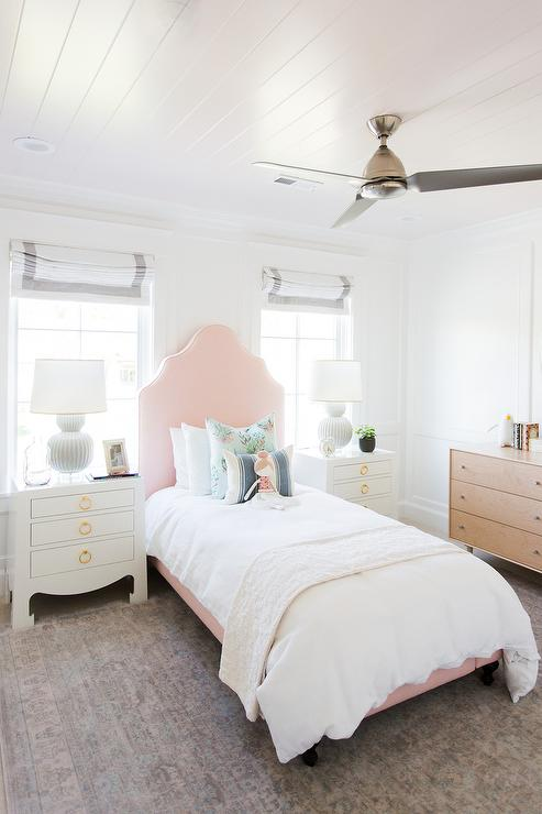 girl room with pink curved headboard