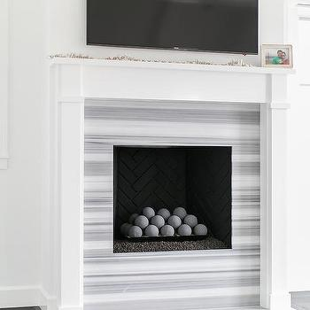 https://cdn.decorpad.com/photos/2016/09/30/m_gray-striped-marble-fireplace-tiles-surround.jpg