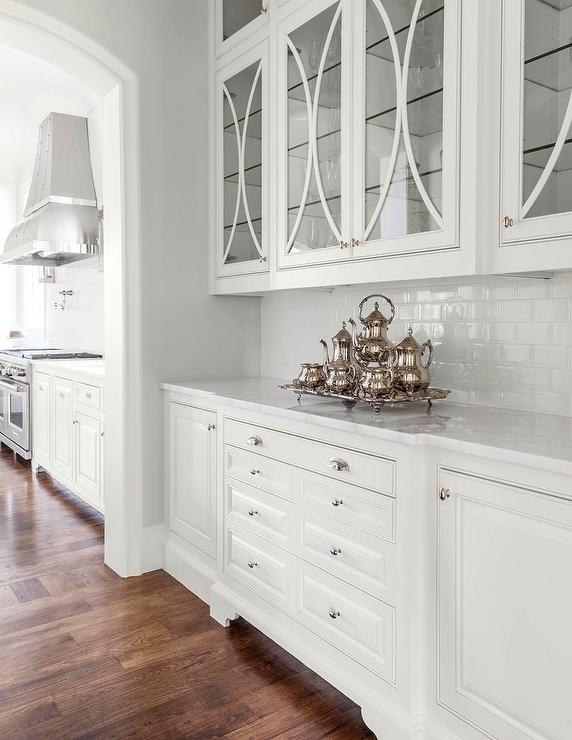 Butler pantry with eclipse mullion cabinets transitional for Shiny white kitchen cabinets