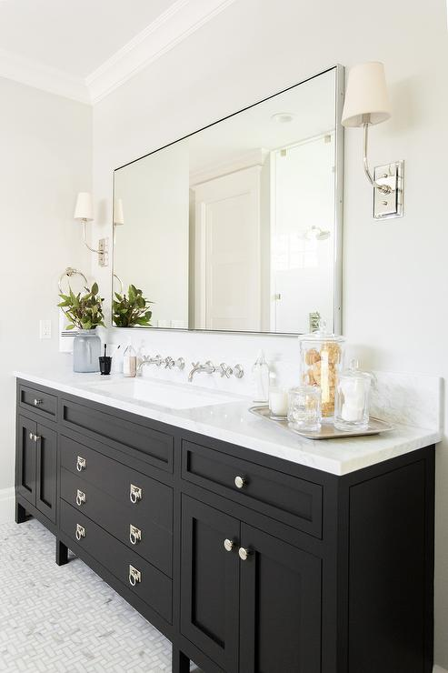 ... Sits On Maze Marble Floor Tiles And Is Fitted With Polished Nickel Ring  Pulls And A White Marble Countertop Holding A Trough Sink Under 2 Wall  Mounted ...