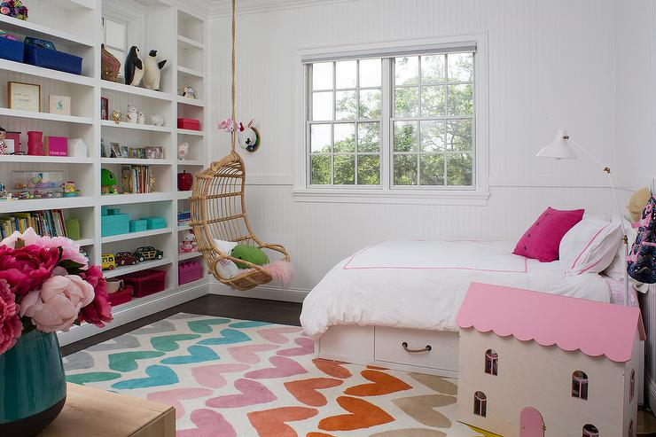 white and pink girl room with hearts rug
