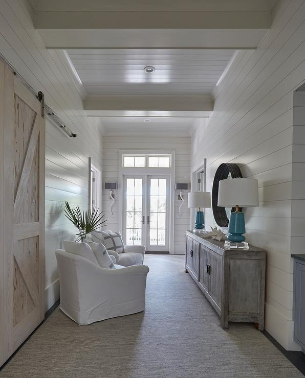 Beach Home Bedroom With Pecky Cypress Barn Door On Rails