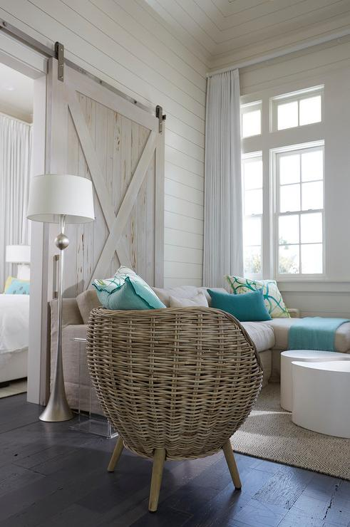 Beach Style Living Room Features A Taupe Sectional Lined With Turquoise  Blue Pillows Alongside A Wicker Pod Chair Illuminated By A Satin Nickel  Floor Lamp ... Part 85