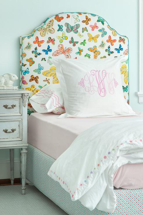 Butterfly Print Headboard With Pink Monogrammed Shams Transitional
