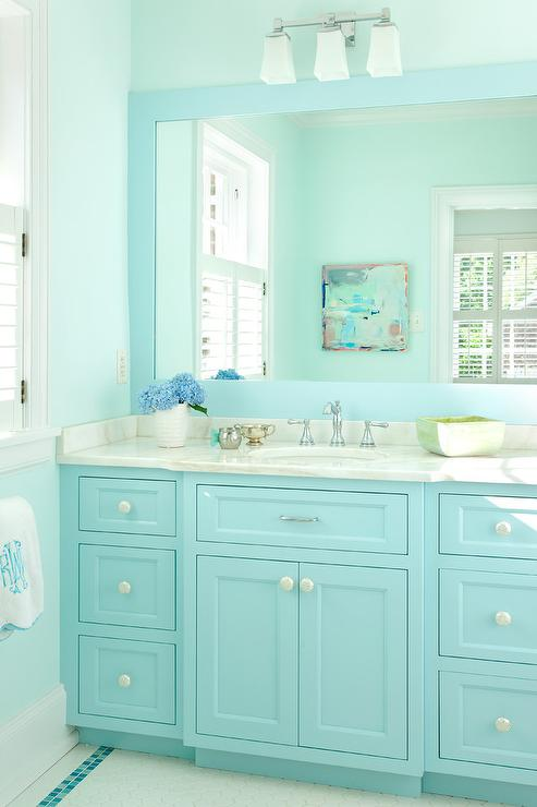 turquoise kidu0027s bathroom features a turquoise blue bath vanity topped with gray and white marble placed under a turquoise blue framed mirror illuminated by