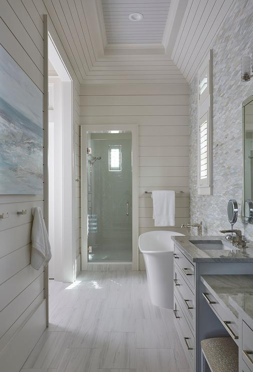 cottage bathroom with horizontal shiplap walls