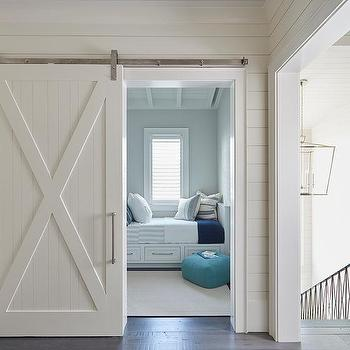 Beach House Kid Bedroom With Row Of Built In Beds