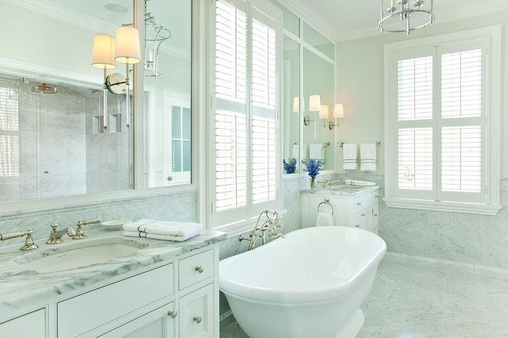 Oval Bathtub Between His And Hers Washstands Transitional Bathroom