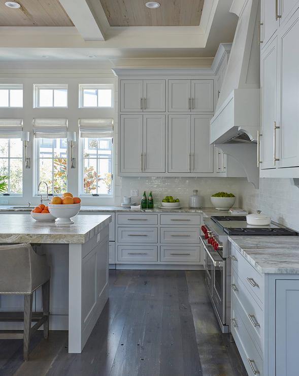 Light Gray Stacked Kitchen Cabinets With Rustic Wood Floors - Light gray wood kitchen cabinets
