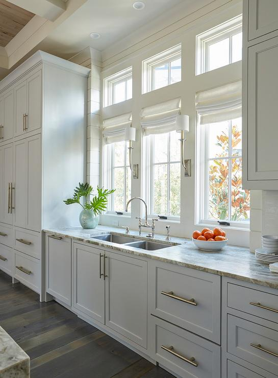 light gray stacked kitchen cabinets with rustic wood