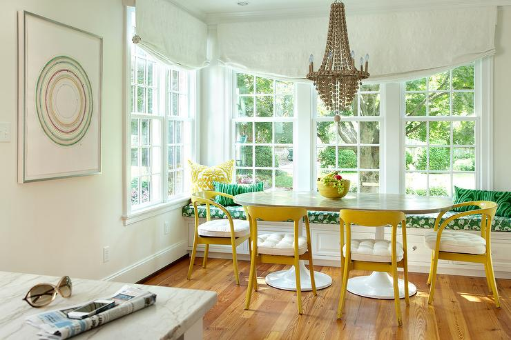 Eclectic Dining Nook With Yellow Chairs