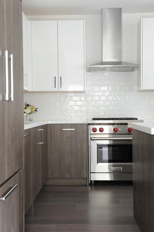 White and gray kitchen with all white subway tiles for Gray and white kitchen cabinets