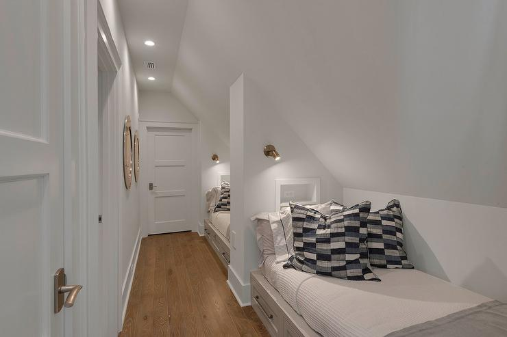 Long Beach House Kids Bedroom With Wall Of Built In Beds