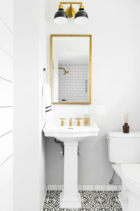 White And Black Mediterranean Powder Room With Antiqued