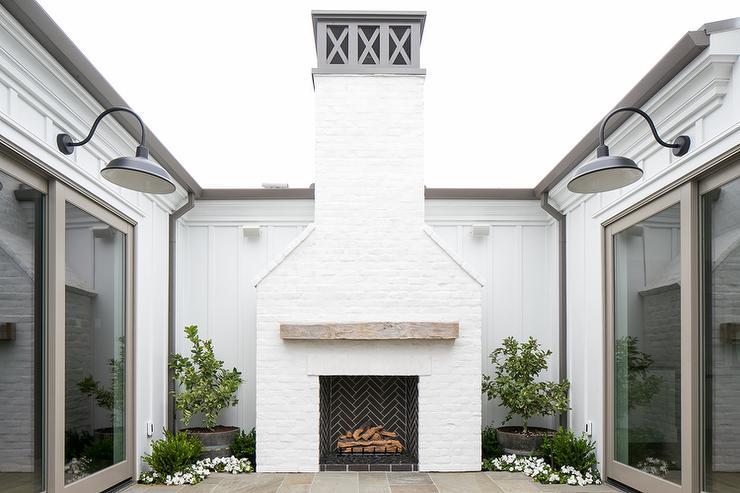 White Brick Outdoor Fireplace With Black Herringbone Firebox