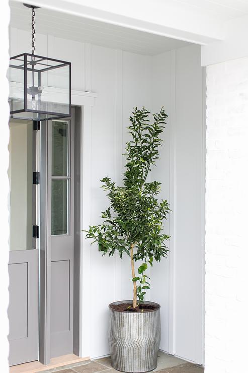 Gray Dutch Front Door With Galvanized Metal Planter