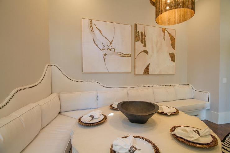 Pink And Gray Abstract Art Over White Built In Dining Banquette