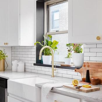 White And Gold Kitchen With Black Windowsill