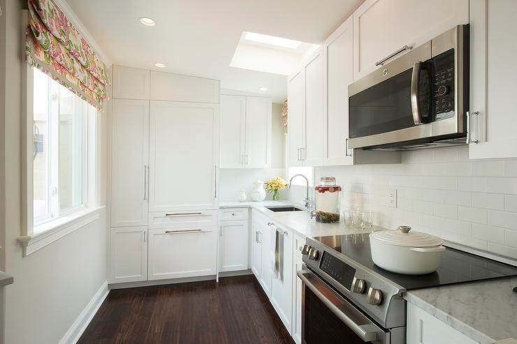 Small White Kitchen With Carrera Marble Countertops Transitional Kitchen