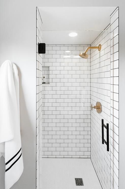 White Subway Shower Tiles With Gray Grout And Brushed Gold