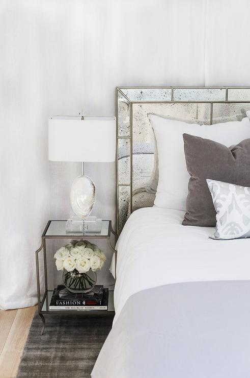 Antiqued Mirror Headboard With White And Gray Bedding Transitional