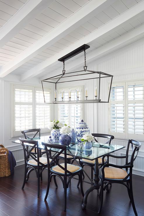 Absolutely Gorgeous Dining Room Features A Sloped Shiplap Ceiling Adorned With White Wood Beams Accented Darlana Linear Pendant Illuminating Black
