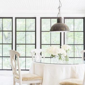 https://cdn.decorpad.com/photos/2016/10/13/m_round-skirted-dining-table-white-wood-chairs.jpg