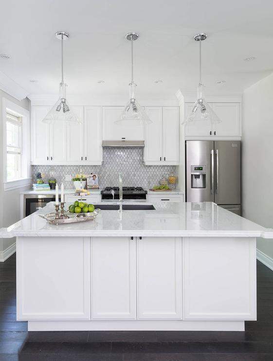 white kitchen cabinets with white arabesque tiles