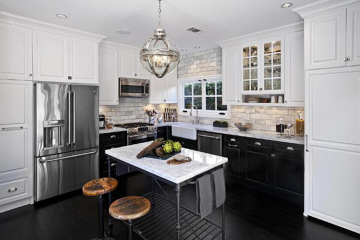 White Upper Cabinets And Black Bottom With French Island