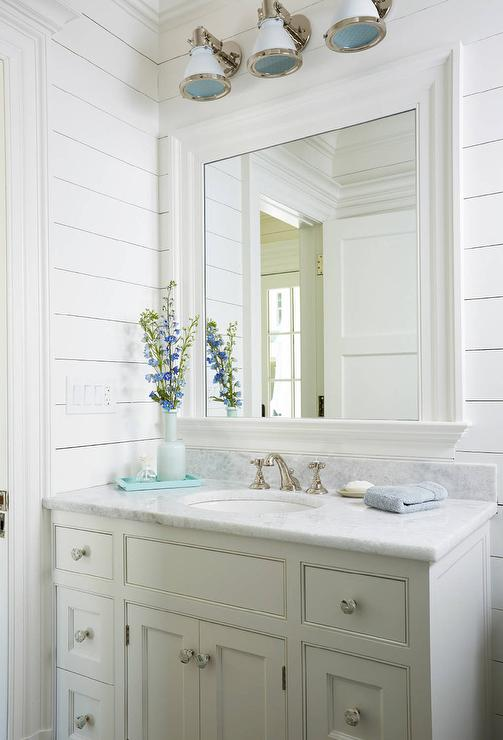 Gray scallop trim on gray sink vanity cottage bathroom for Coastal bathroom design
