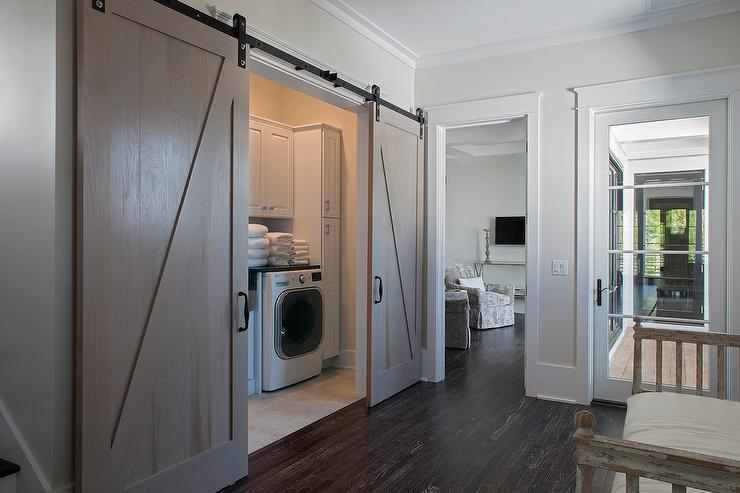 Hall Laundry Room With Gray Wash Barn Doors On Rails