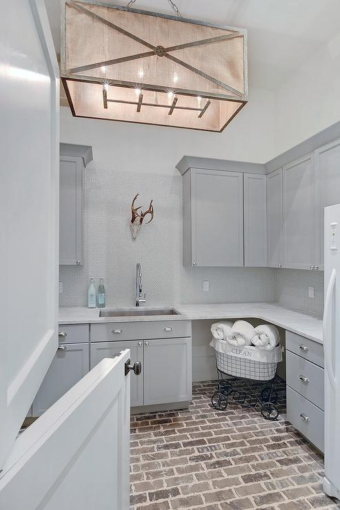 Gray Laundry Room With Brick Floor