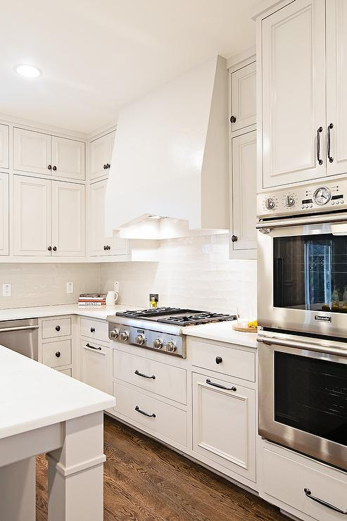 White Kitchen Cabinets With White Glass Backsplash Tiles