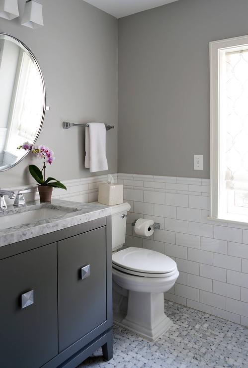 white and gray bathroom with black washstand