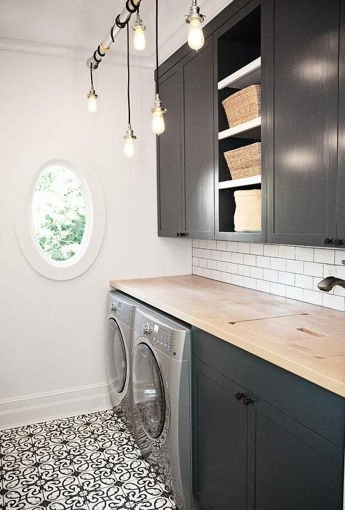 Black And White Laundry Room With Beveled Mirrored Subway