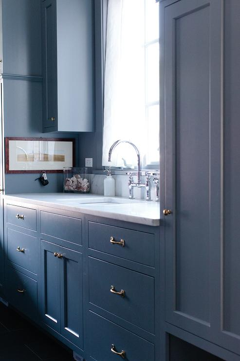 Blue Laundry Room Cabinets With Brass Hardware