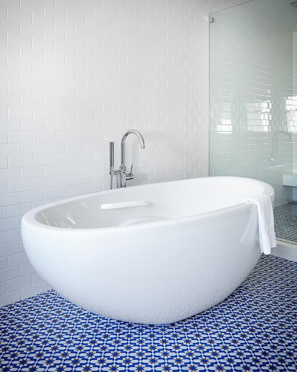 Contemporary Bathroom Features An Egg Shaped Bathtub Placed Atop A White  And Blue Moroccan Tiled Floor Situated Next To A Walk In Shower Clad In All  White ... Part 88