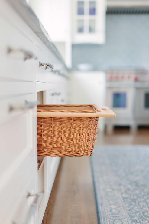 White and Blue Kitchen with Pull Out Wicker Vegetable Baskets