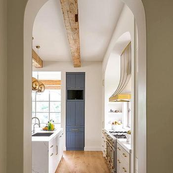 Arched Kitchen Doorway With French Hood And Stove