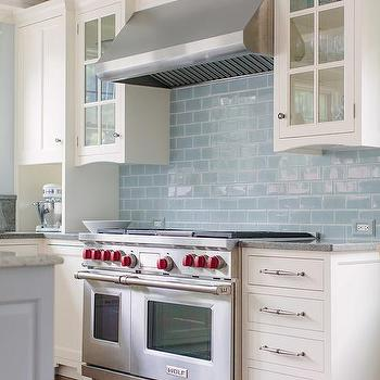 Elegant White Kitchen Cabinets With Blue Glazed Subway Tiles