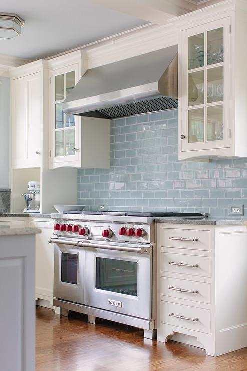 White Kitchen Cabinets With Blue Glazed Subway Tiles Transitional