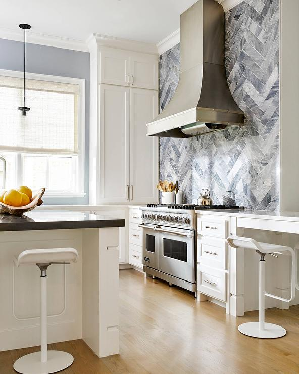 White Kitchen Herringbone Backsplash white kitchen with gray marble herringbone tile backsplash