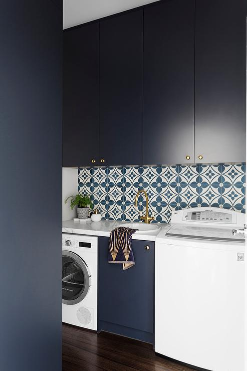 Dark Blue Laundry Room with Brass Accents