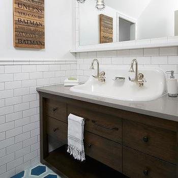 Blue boy bathroom with blue ship blueprint wallpaper cottage brown washstand with trough sink and blue hex floor malvernweather Images