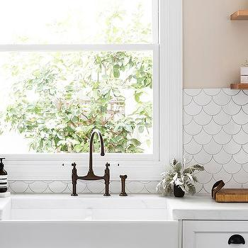 White and beige kitchen with copper accents transitional for Fish scale backsplash