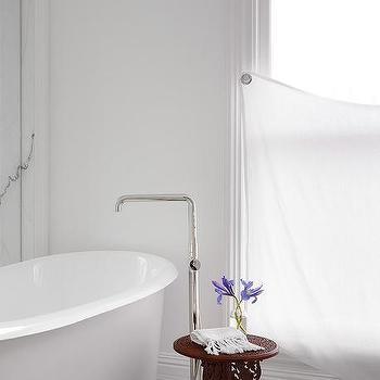 Roll Top Bathtub with Floor Mount Tub Filler. Wood Bathroom Side Table Design Ideas