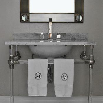 Nickel And Glass Sink Vanity With Marble Top